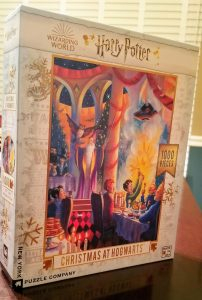 photo shows a puzzle box with refs, yellows, blues, and oranges, depicting a scene of Hogwarts at Christmas