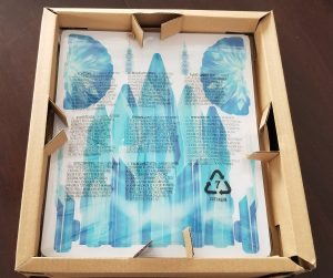 Inside of Frozen puzzle box with pieces in sheets that need to be broken apart